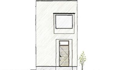 大きな出窓と漆喰の塗壁に馴染む木製扉がかっこいい経年変化を楽しむおうち